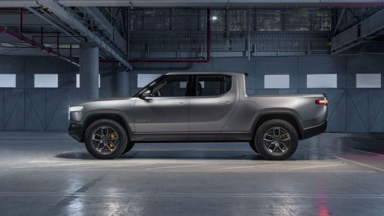 2022 Rivian R1T in grey parked in a warehouse
