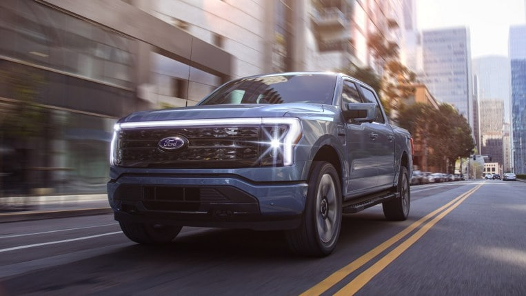 2022 Ford F-150 Lightning in blue driving