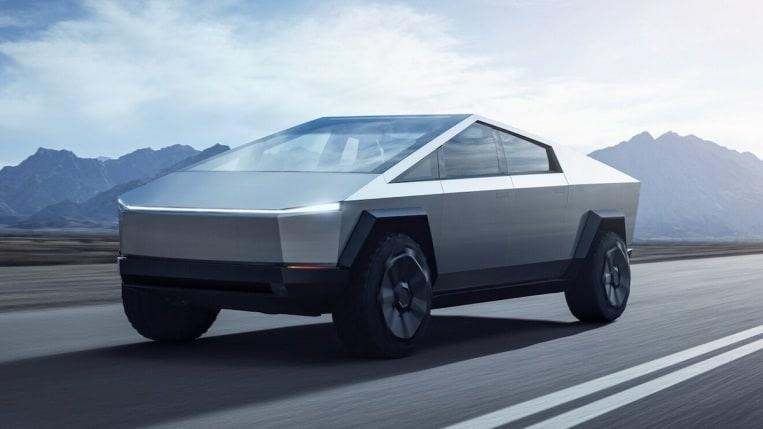 Tesla Cybertruck in silver driving