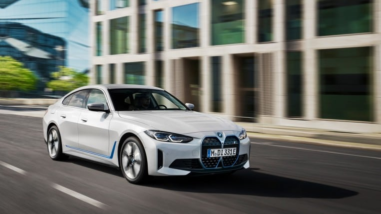 BMW i4 in white, driving