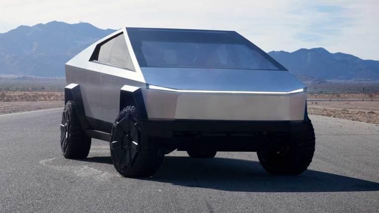 Tesla Cybertruck on the road in the desert.