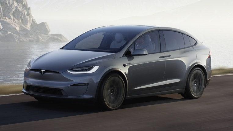 2021 Tesla Model X in gray, driving.