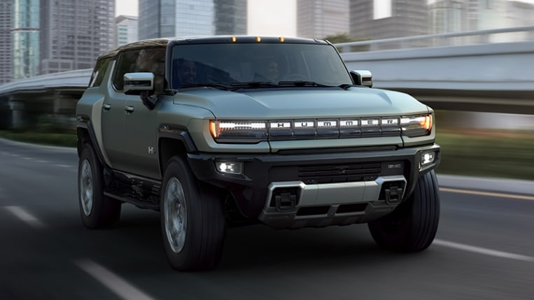Hummer EV SUV on the highway driving.